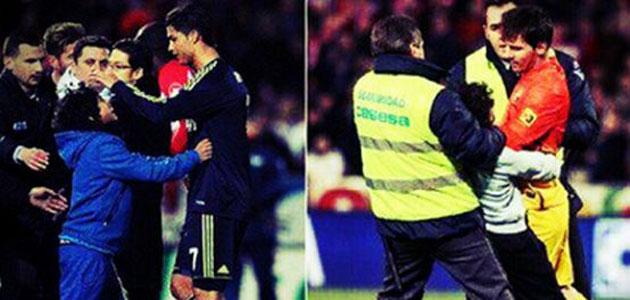 面对同一小球迷送拥抱,C罗梅西反应大不同