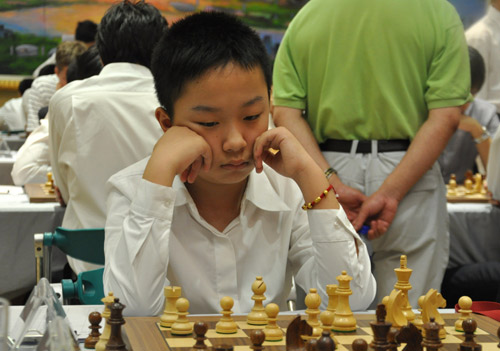 13岁韦奕晋升国象特级大师,世界最年轻