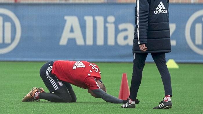 伤势反复,罗本在训练中背部疼痛